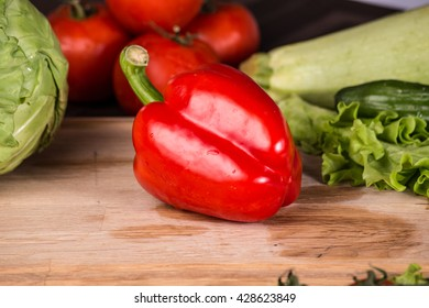 Red pepper and fresh vegetables on the table - close up photo