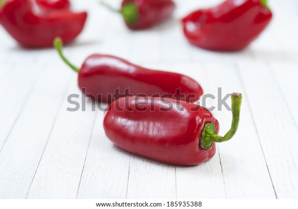red pepper fruits on white wood table