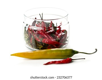 Red pepper in a glass jar and yellow pepper