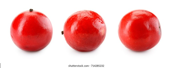 Red pepper isolated on white. Red Peppercorn. Pink peppercorns. Macro. Top view. Full depth of field.