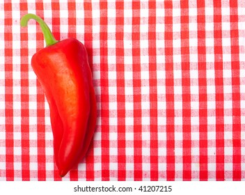 red pepper on checked background