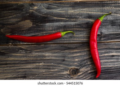 Red pepper on a wooden background in rustic style