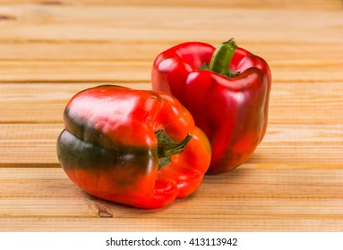 Red pepper on wooden table