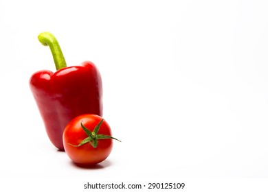 Red Pepper And Red Tomato On Simple White Background