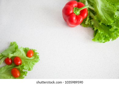 Red pepper, tomatoes and salad. Healthy food. Raw vegetables. Background.