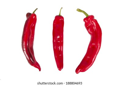 red peppers on white background, fresh vegetables