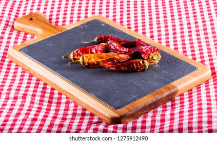 Red peppers over cutting board, horizontal image