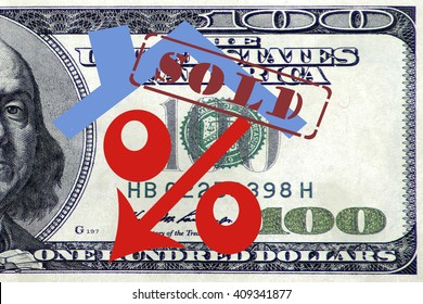 Red percent sign with arrow on the background of banknotes