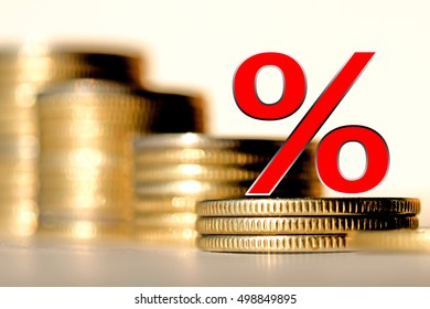 Red percent sign on a background of money . The concept of changes in market prices .