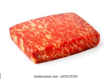 Red pesto gouda cheese on a white background