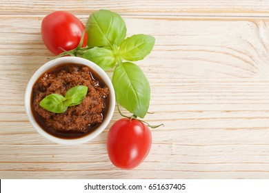 red pesto on a wooden background