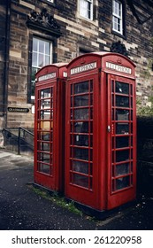 Red phone booth in Edinburgh. The red telephone box is a famous feature of the British landscape.