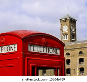 Red phone booth in St. Katherine dock  London.