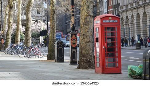 red phone box on London street