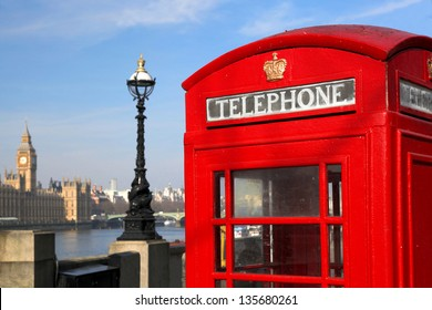 Red phone boxes against Big Ben in London, UK