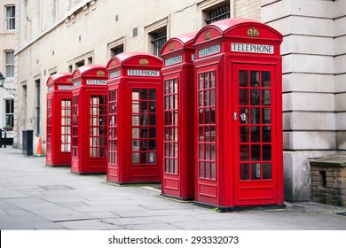 red phone boxes in Covent Garden at day