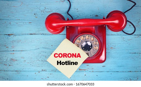 red phone hotline - calling for information about Coronavirus disease named COVID-19