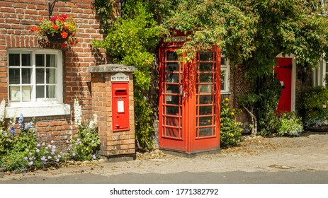 Red Phonebooth and postbox, Warrington, UK