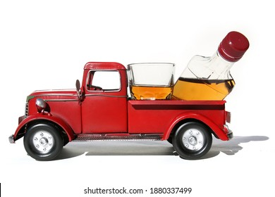 Red Pick Up Truck. Vintage Red Pick Up Truck with Whiskey or Liquor in the back. Red Truck with Pint and Shot Glass of Whiskey or Liquor. Isolated on white. Room for text.