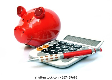 Red piggy bank with calculator and ball pen
