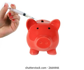 Red piggy bank getting injection