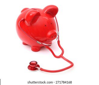 Red Piggy Bank wtih stethoscope on White Background