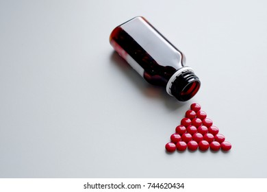 Red pills and bottle on table. Medicine and pharmaceutics for health care