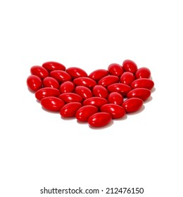 RED pills medicine heart shape on white background