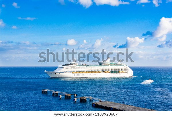 Red Pilot Boat Cruising Past Cruise Ship