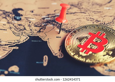Red pin and bitcoin on India (world map). Regulations of cryptocurrency in India concept.