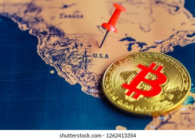 Red pin and bitcoin on USA (map). Regulations of cryptocurrency in United States concept.