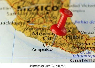 Red pin on Acapulco city in Mexico. Copy space available.