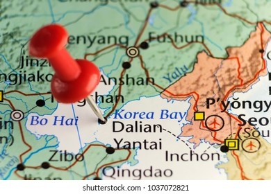 Red pin on Dalian, China. Copy space available.