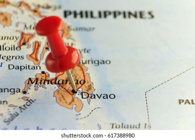 Red pin on Davao, Philippines. Copy space available.