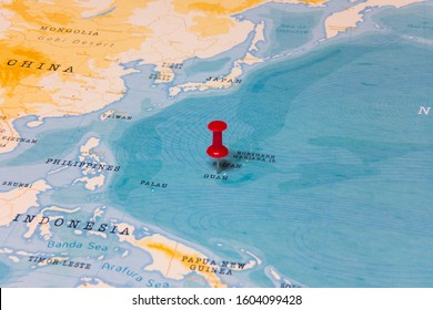 A Red Pin on Guam of the World Map