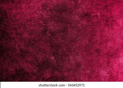 Red pink or burgundy suede texture. Leather skin natural pattern or abstract background.