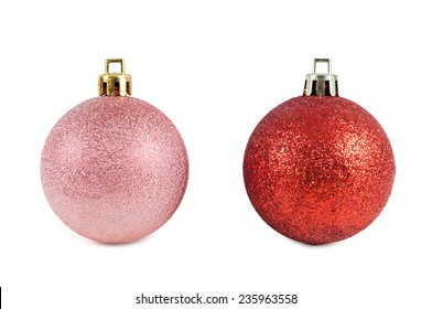 Red and pink christmas baubles isolated on white background with clipping path