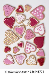 Red and pink heart cookies on a white background