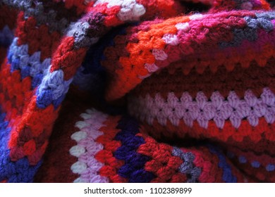 red pink and purple striped crochet blanket photo
