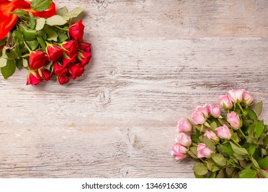 Red and pink roses on white wooden background with copy space