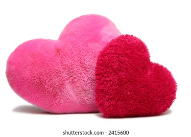 Red and pink soft hearts on a white background