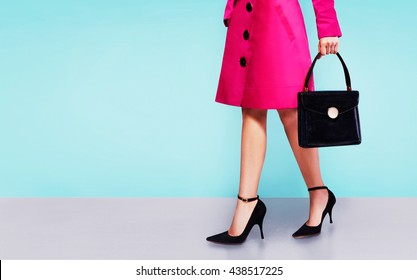 Red pink trench coat woman walking  isolated on colorful  background.