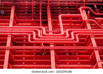 Red pipes aboard the deck of a crude oil tanker