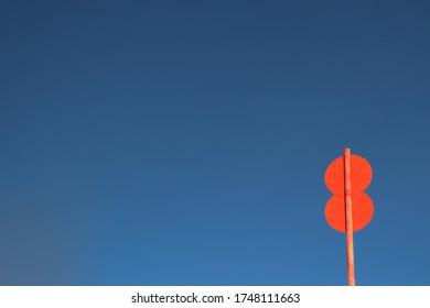 Red piste sign against blue sky in ski resort Venet,  Austria.