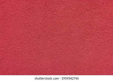Red plaster facade texture background. External facade of the building, plaster with clear texture.