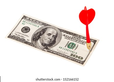 Red, plastic arrow and one hundred dollar bill, isolated on white background.