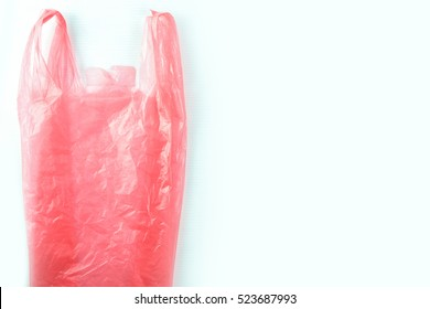 red plastic bag with copy your text space white background,environment issue