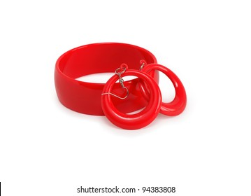 Red plastic bangle and pair of earring on white background. Isolated with clipping path