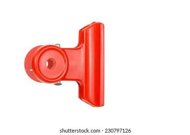 Red Plastic bulldog clip isolate on white