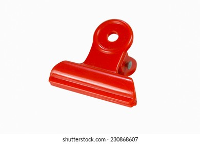 Red Plastic bulldog clip isolate on white